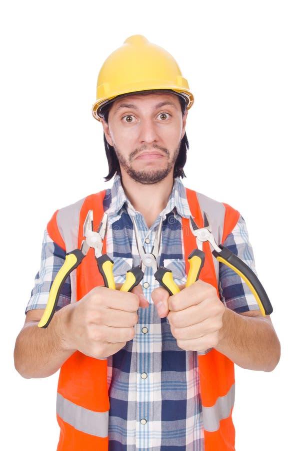 Молодой рабочий-строитель при острозубцы изолированные дальше стоковое изображение rf