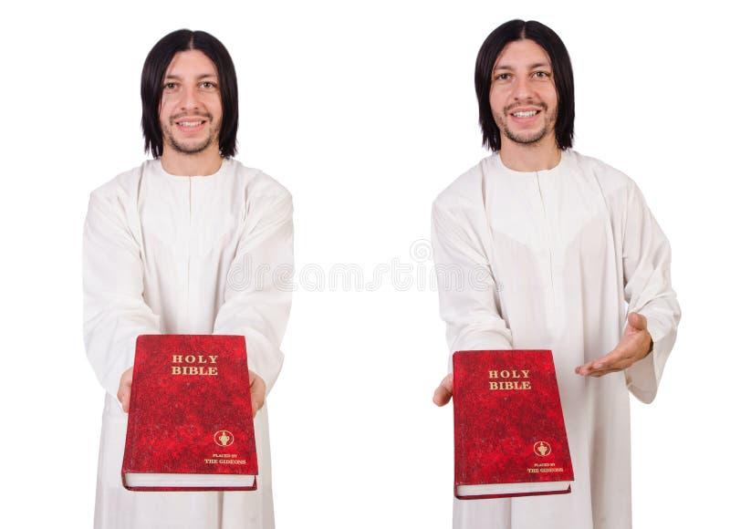 Молодой священник при библия изолированная на белизне стоковое фото rf