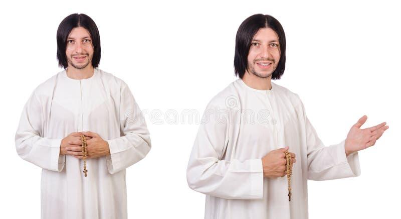Молодой священник при библия изолированная на белизне стоковые фото