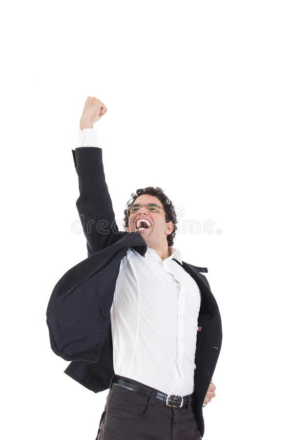 Молодой счастливый бизнесмен скачет в черный костюм на белизне стоковые фотографии rf
