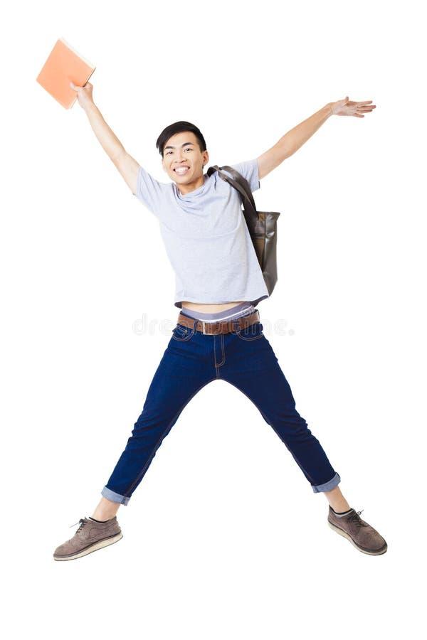 Молодой счастливый скакать студента стоковая фотография rf