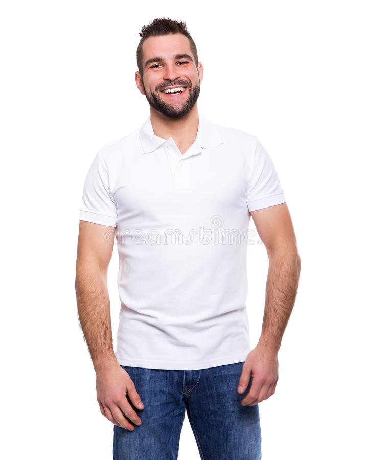 Молодой счастливый человек в белой рубашке поло стоковые изображения rf