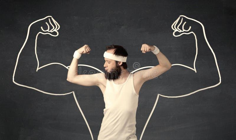 Молодой слабый человек с вычерченными мышцами стоковое фото rf
