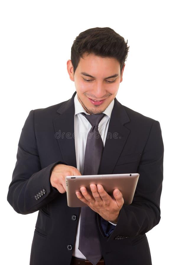 Молодой успешный бизнесмен с таблеткой, латинской стоковые изображения rf