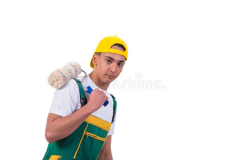 Молодой художник ремонтника при ролик изолированный на белизне стоковое фото rf