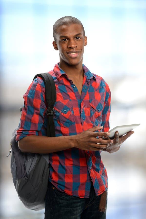 Молодой черный студент стоковое фото rf