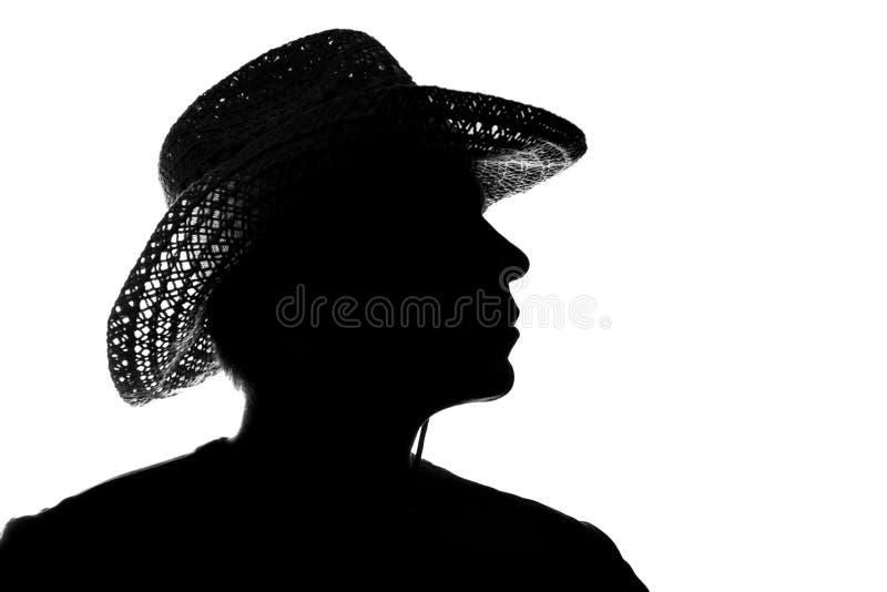 Молодой человек в соломенной шляпе - силуэт стоковое изображение rf