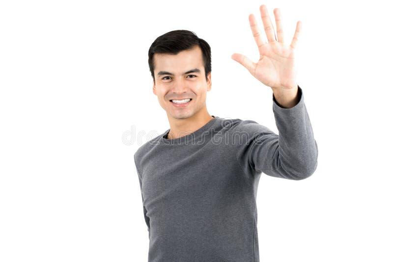 Молодой человек делая жест максимума 5 стоковые фотографии rf
