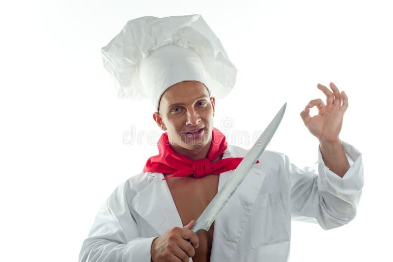 Молодой человек кашевара и большой нож стоковые фото