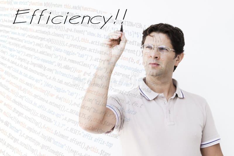 Молодой человек пишет ` эффективности ` стоковое фото rf