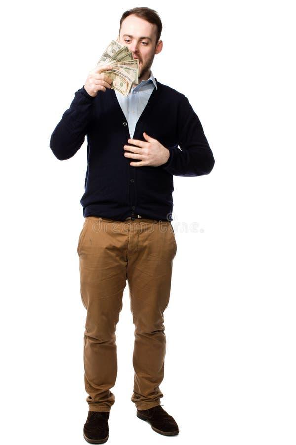 Молодой человек предусматривая пригорошню наличных денег стоковые изображения