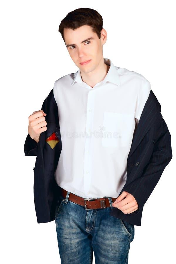 Молодой человек принимает его куртку стоковое изображение
