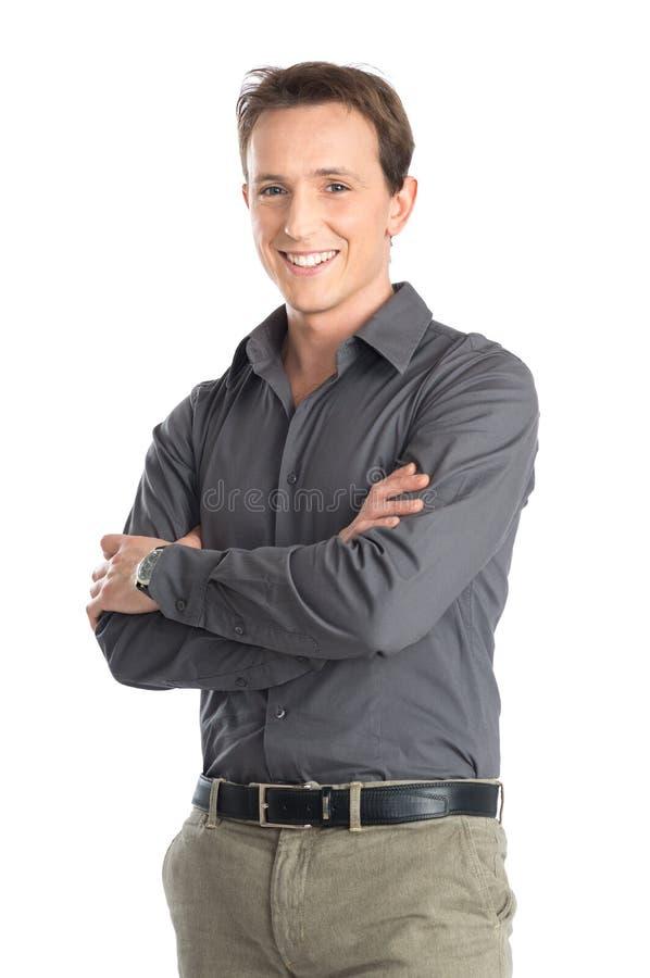 Молодой человек при пересеченная рука стоковое фото