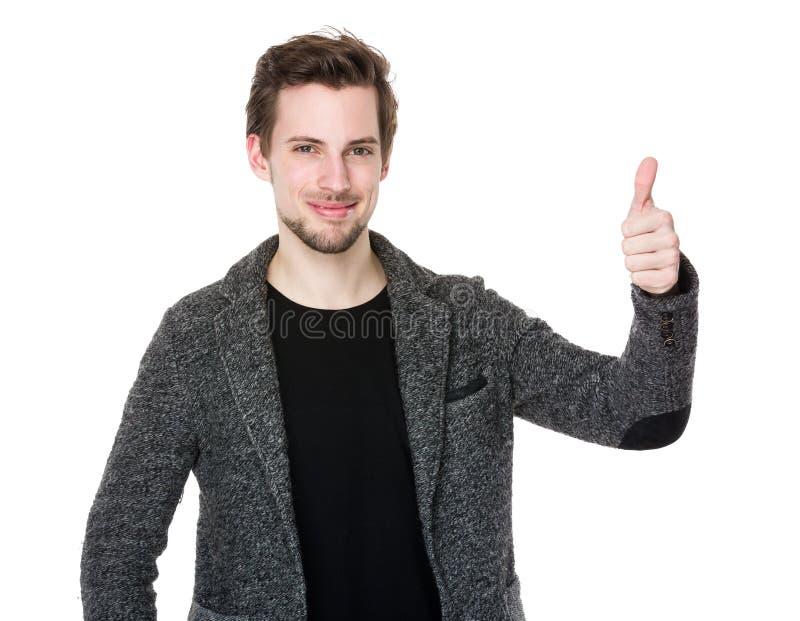 Молодой человек с большим пальцем руки вверх стоковое фото