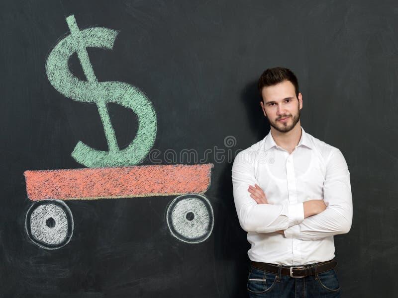 Молодой человек с деньгами сбережений бороды стоковое изображение rf
