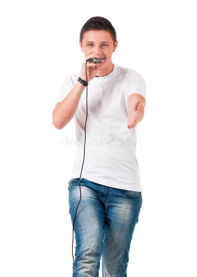 Молодой человек с микрофоном стоковая фотография rf