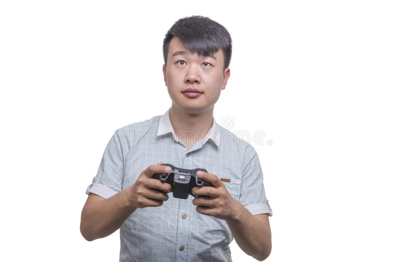 Молодой человек с пусковой площадкой управлением видеоигры стоковое изображение