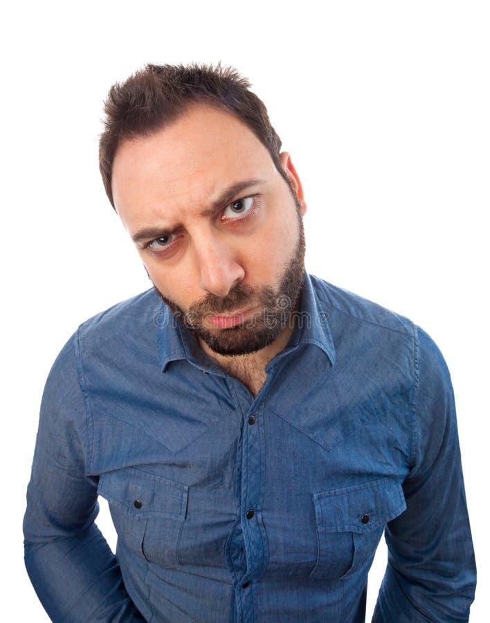 Молодой человек с сердитым выражением стоковая фотография