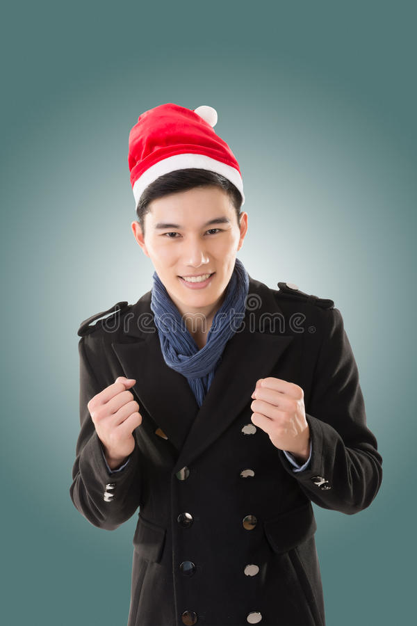 Молодой человек с шляпой рождества стоковое изображение rf