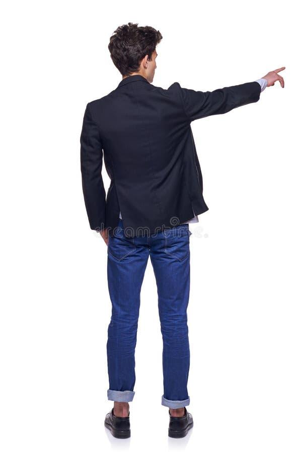 Молодой человек указывая, задний взгляд стоковая фотография