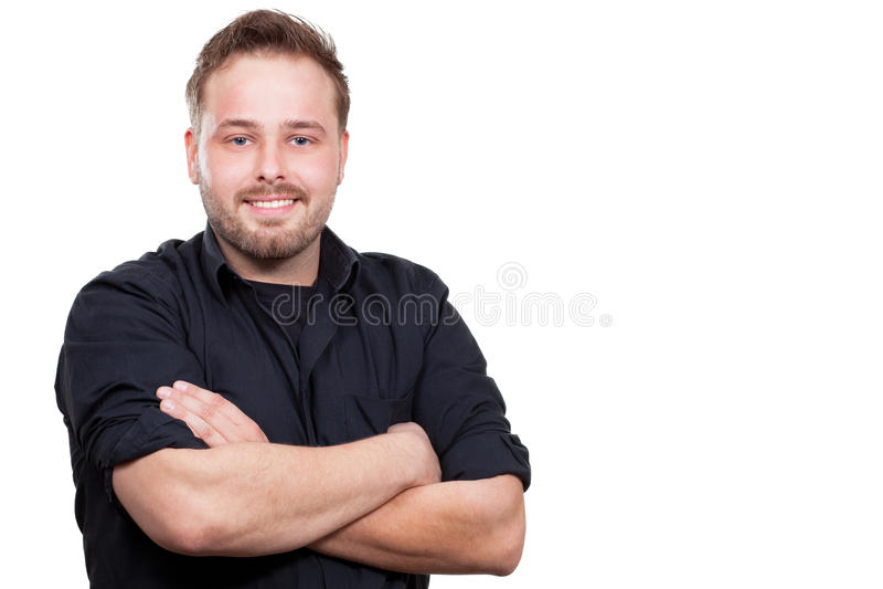 Молодой человек усмехается стоковое фото