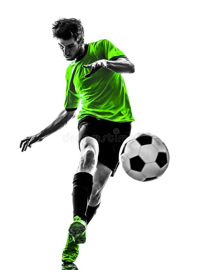 Молодой человек футболиста футбола пиная силуэт стоковое изображение