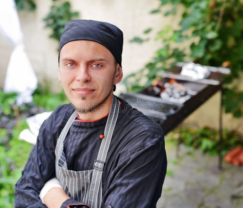 Молодой шеф-повар стоковое фото rf