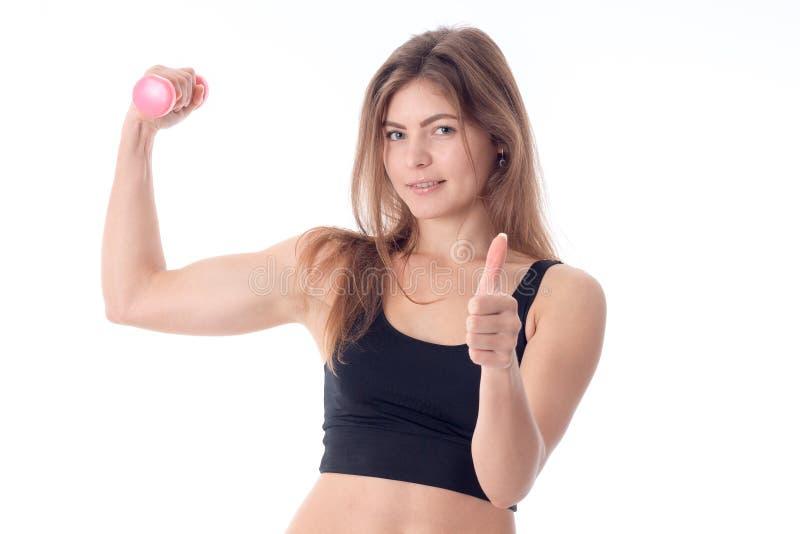 Молодые атлетические выставки девушки классифицируют и ее мышцы стоковое изображение