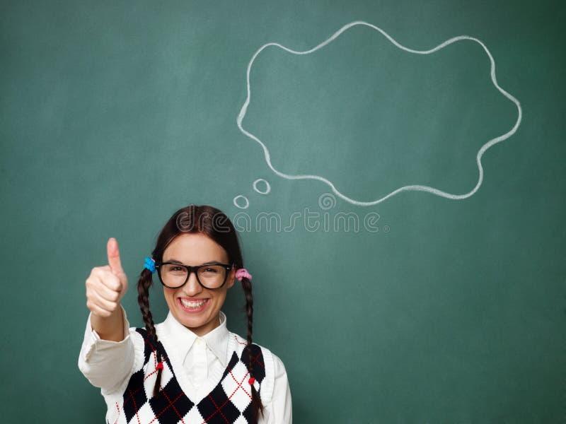 Молодые женские большие пальцы руки болвана вверх стоковое изображение rf