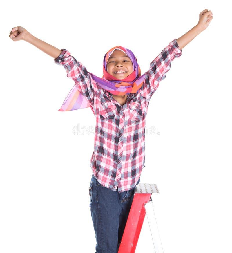 Молодые мусульманские девушка и лестница VII стоковое фото rf