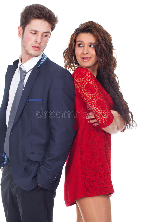 Молодые пары стоя спиной к спине Стоковые Фото