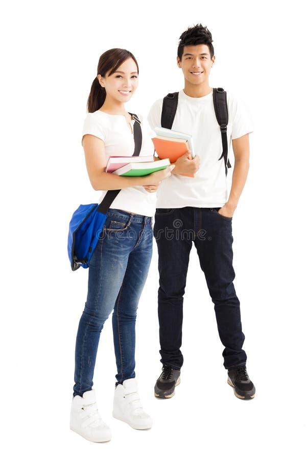 молодые пары студентов с книгами стоковое изображение rf