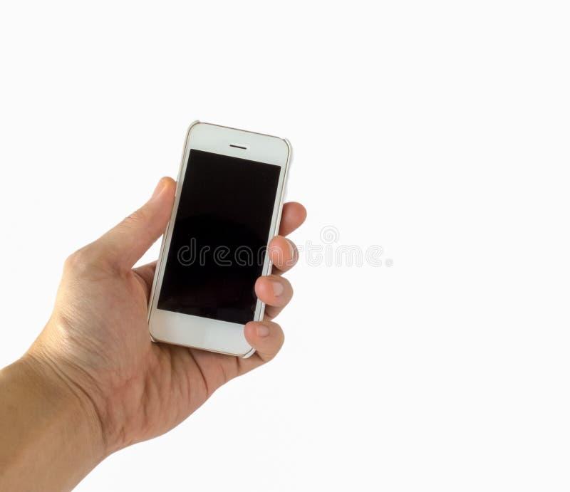 Мужская рука держа белый Smartphone с пустым черным экраном на белизне стоковое изображение