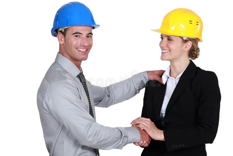 Мужские и женские архитекторы стоковое изображение