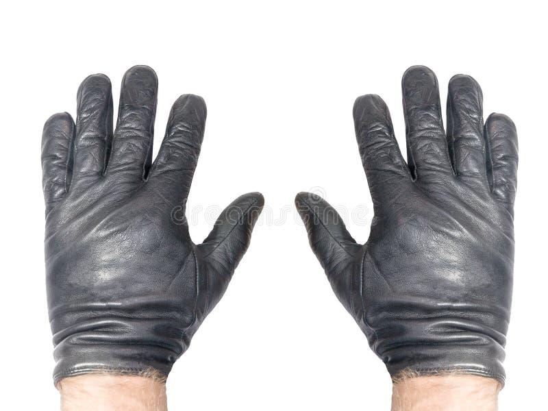 Мужские руки в черных кожаных перчатках изолированных на белой предпосылке стоковое фото rf