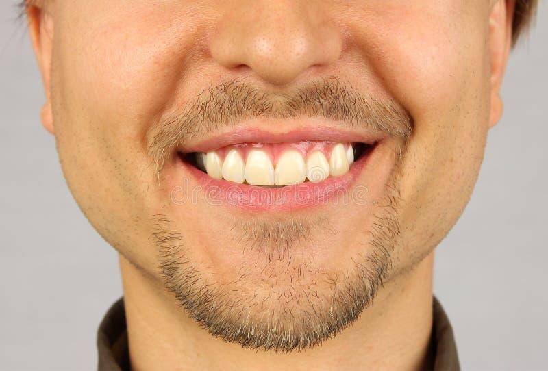 Мужской рот с улыбкой стоковые изображения