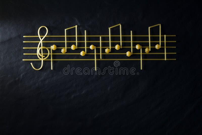 Музыкальный затир нот рождества изолированный на черной текстурной предпосылке стоковое изображение