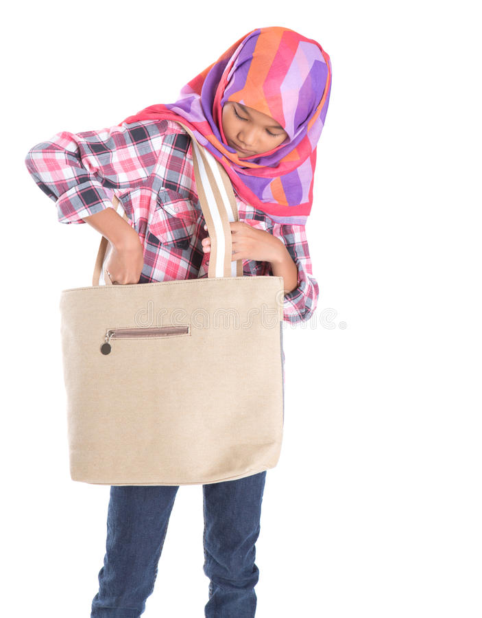 Мусульманская девушка школы с сумкой IV стоковая фотография