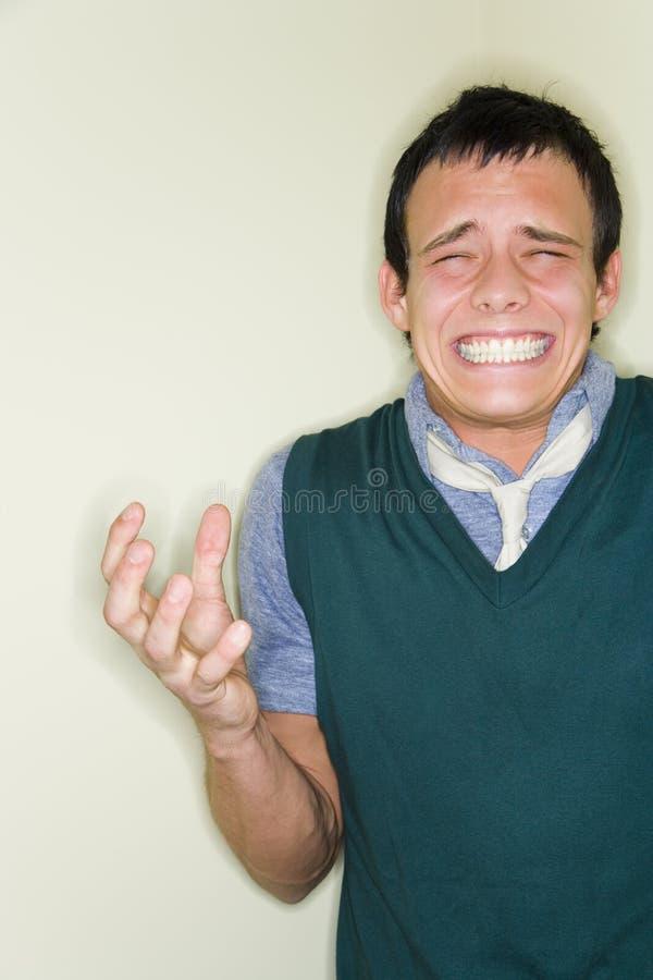 мучительный человек выражения стоковые фото