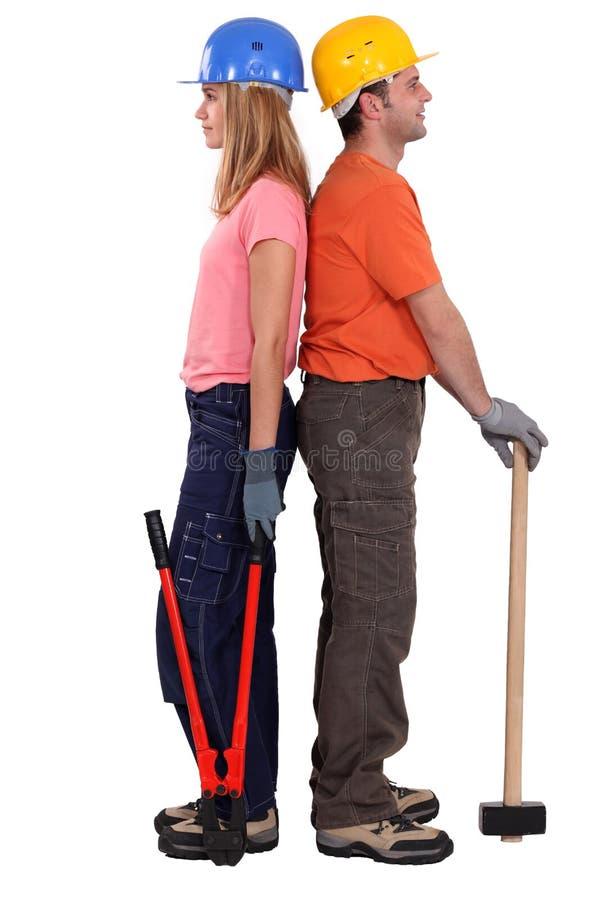 Мыжские и женские строители стоковая фотография