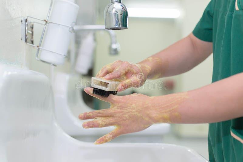 Мытье вручает хирургию стоковые изображения rf