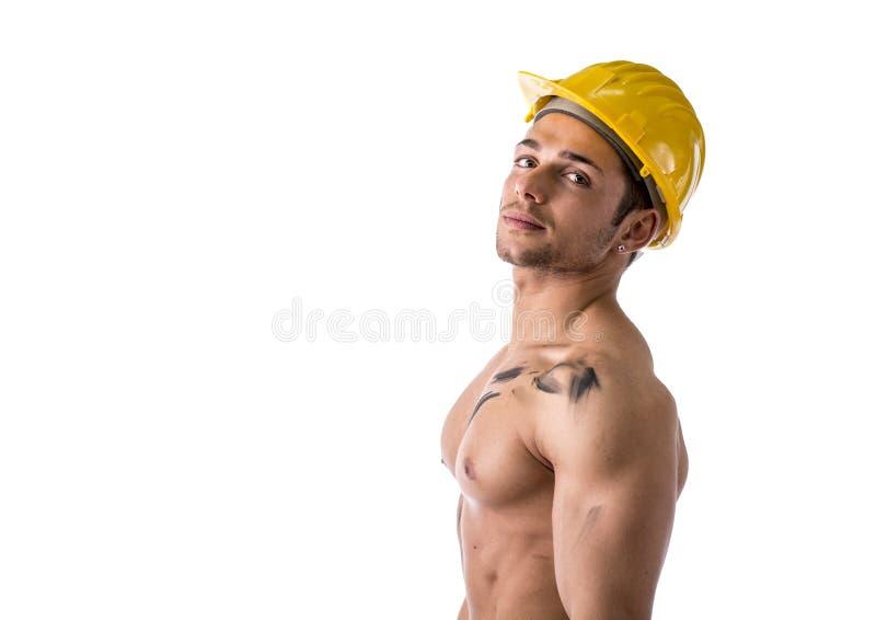 Мышечный молодой рабочий-строитель без рубашки стоковое изображение rf