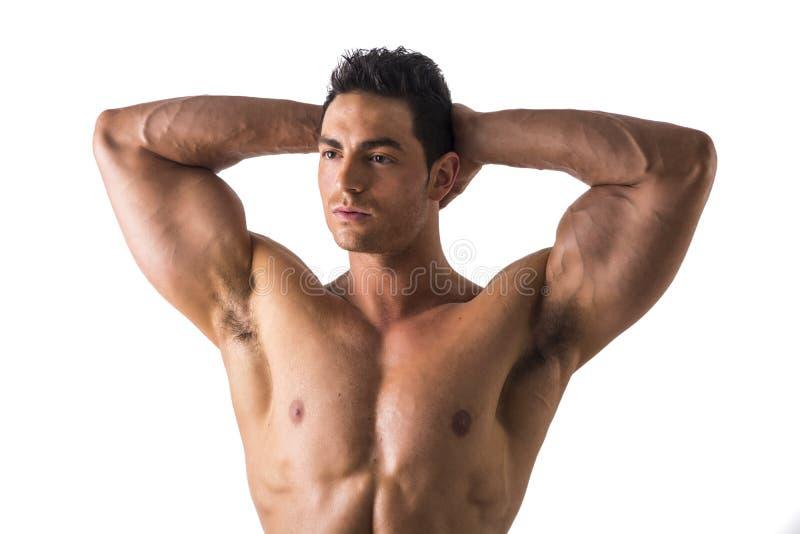 Мышечный человек смотря Afar пока держащ его голову стоковые фотографии rf