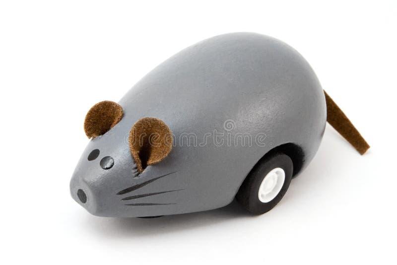 мышь над деревянным игрушки белое стоковое фото