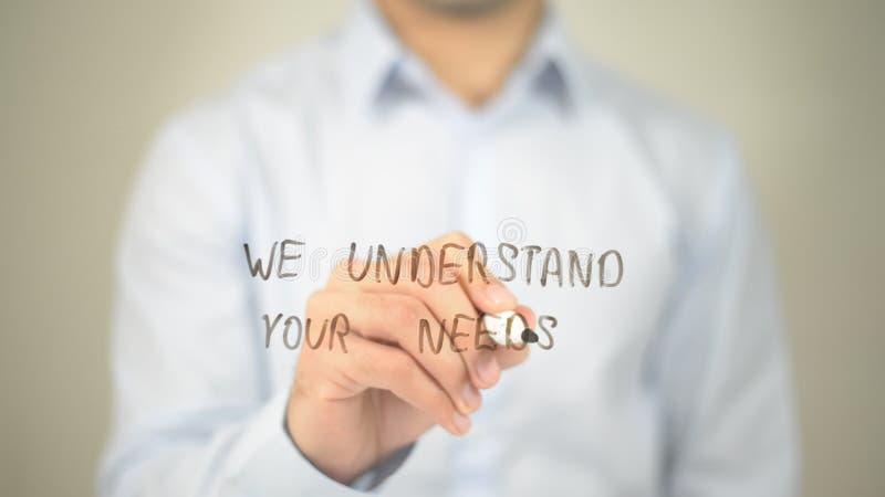 Мы понимаем ваши потребности, сочинительство человека на прозрачном экране стоковое изображение