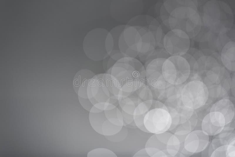 Мягкая серая предпосылка bokeh, фотографирует с цифровой фотокамерой стоковое изображение rf