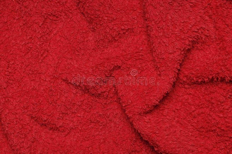 Мягкое полотенце Terry красное как предпосылка стоковые фото