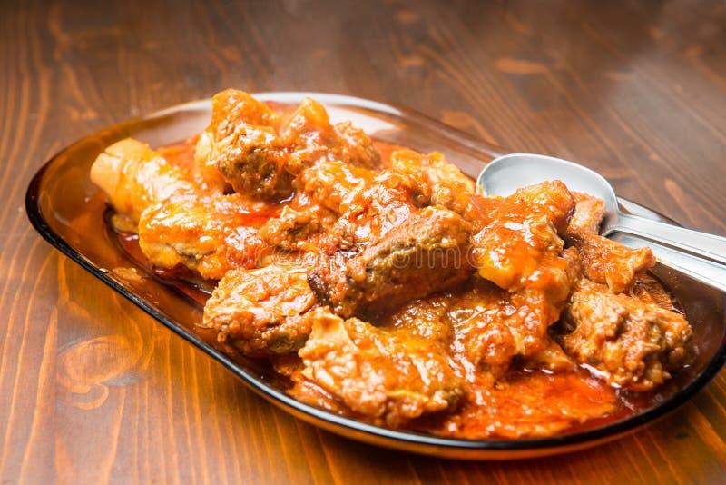 Мясо в соусе стоковая фотография