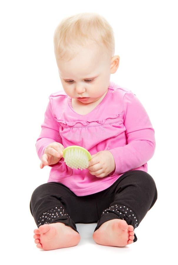 Младенец в розовой куртке и черные брюки рассматривают стоковые изображения