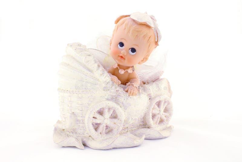 Младенец в экипаже, изолированном на белизне стоковое изображение